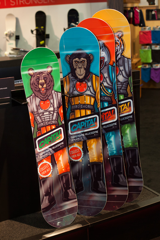 Capita comes in with the brightest graphics in the building again this year, including their Micro-Scope line of kids boards.