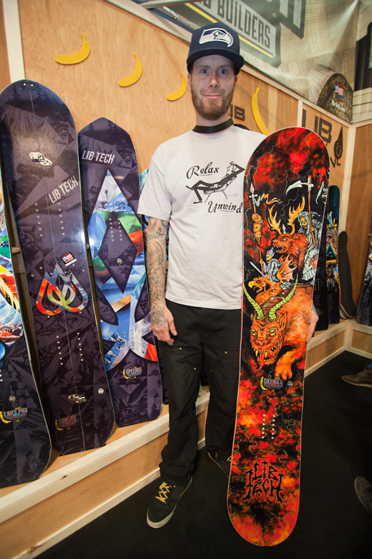 Quincy Quigg poses with the latest Skunk Ape freeride/freestyle board featuring his original artwork.